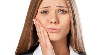dolore dentizione permanente